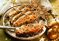 Sliced stollen on Christmas plate