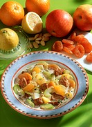 Celery stew with oranges, apricots & flaked almonds