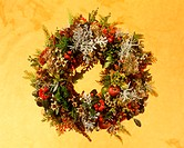 Christmas flower arrangement on yellow background