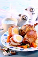 Hard-boiled eggs wrapped in ham