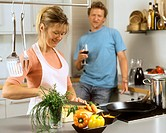 Kitchen scene: woman cutting vegetables, man with wine glass (1