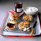 Scones with raisins, strawberry jam, clotted cream