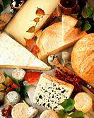 French cheeses and bread among fruit and leaves