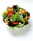 Mixed salad leaves with vegetables & sheep´s cheese in dish