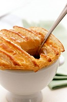 Soup with puff pastry topping (broken with a spoon)