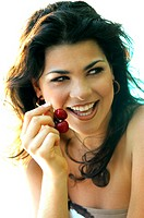 Young woman eating cherries (3)