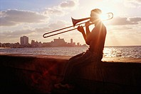 Silhouette of a trombone player on the Malecón. Havana, Cuba