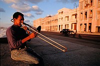 Trombone player on the Malecón at sunset. Havana, Cuba