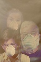 Photo illustration of pollution: a family wearing filter masks to protect against air pollution.