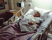 Elderly female patient responding to a morphine drip after surgery.