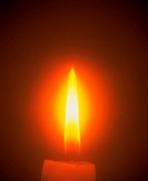 Close-up of bright flame from a burning candle.