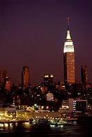 Empire State Building at night above the East River, New York City.