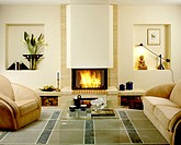 Living room with fireplace and burning fire