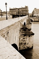 Pont du Carrousel and typical Paris buildings. Paris. France