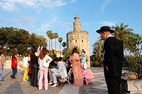 Chinese wedding by the Torre del Oro. City of Sevilla. Andalucia. Spain
