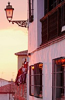 Façade of house and tourists at sunset in the Albayzin. Grenada. Andalucia. Spain