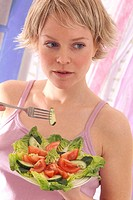 WOMAN EATING SALAD<BR>Model.