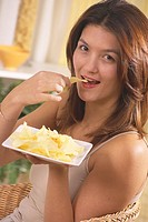 WOMAN SNACKING<BR>Model.