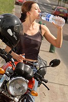THIRSTY WOMAN<BR>Model.<BR>Motorcyclist enduring the heat. Dehydration.