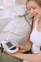 BLOOD PRESSURE, WOMAN<BR>Model.<BR>Blood pressure self-monitoring.