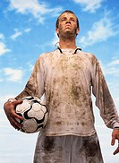 Low Angle View of a Sweaty Football Player Covered in Mud