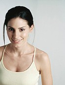 Young woman wearing tank top smiling at camera