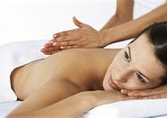 Woman massaging second woman on massage table