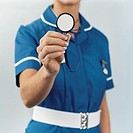 Mid Section Shot of a Nurse Holding a Stethoscope
