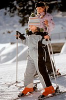 Two girls skiing