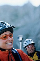 Smiling cyclists in mountains