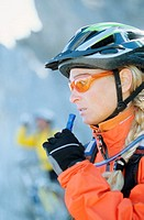 Side view of female cyclist
