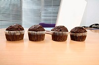Chocolate muffins on desk