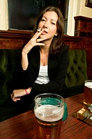 Woman smoking in a bar