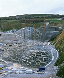 Eden Project construction. Cranes and the geodesic framework for the Eden Project domes, in Cornwall, England. The domes were built from 1997-2001, an...