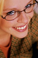 woman with glasses, smiling