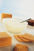 biscuits and a glass bowl with yogurt