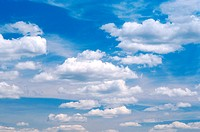 Cumulus clouds in a blue sky.