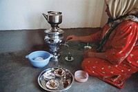 Preparing tea from a samovar Kurdistan Iraq 2004
