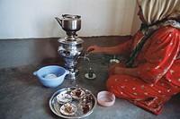 Preparing tea from a samovar Kurdistan Iraq 2004