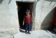 Kurdish boy outside his house Kurdistan Iraq 2004