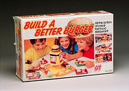 A game for two to four players aged five and over, marked 'All the fun of a real fast food restaurant!'. Players compete to be the first to assemble a...