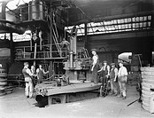 Workers using the tyre rolling mill at the forge at Horwich works, 1919. This is where molten metal for locomotive tyres is rolled into shape.  Horwic...