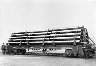Pipes loaded onto a Great Western Railway wagon, about 1903.  Heavy goods like this were usually transported by rail at this time. Competition from ca...