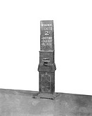 Workmen´s ticket machine at a North London Railway station, about 1900.   At this time travelling to work by train was becoming more common. Workers c...