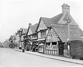 Shops on the main street in Gerrard's Cross, Buckinghamshire, 1925.  Gerrard's Cross was not far from London. Many people who worked in London lived i...