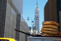 Empire State Building in urban setting with pretzel stand in foreground, New York City, New York (thumbnail)