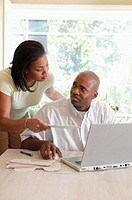 Couple doing finances using laptop