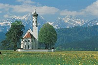 Bavarian Alps behind St. Coloman Church. Germany