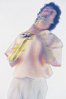 Man playing saxophone, blurred