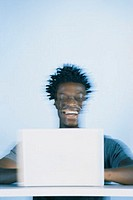 Man with laptop, blurred